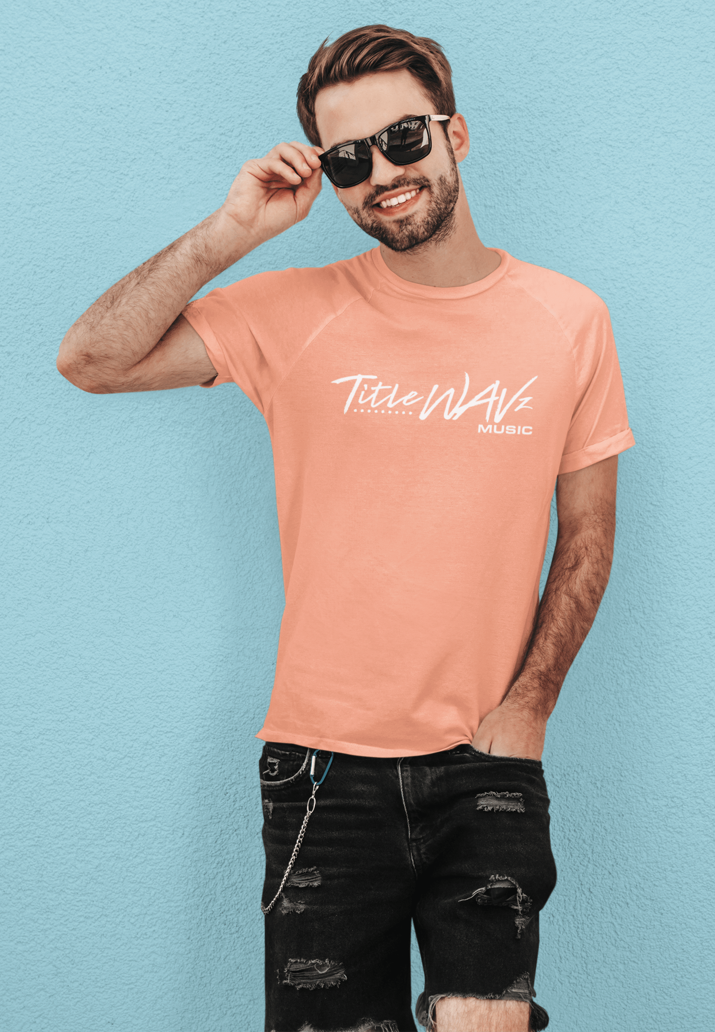 basic-tee-mockup-featuring-a-happy-man-with-sunglasses-leaning-against-a-colored-wall-m1504-r-el2